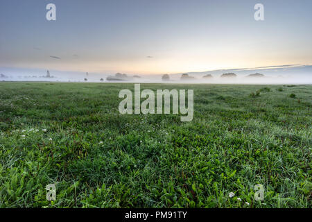 Fog in the landscape. Morning haze by the sunrise. - Stock Image