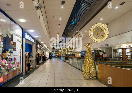 A section of Buchan Galleries shopping mall in the centre of Glasgow, Scotland, decorated for Christmas. The anchor shop, John Lewis, is at the far si - Stock Image