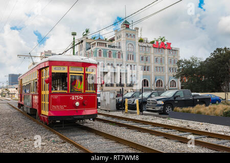 New Orleans streetcar, view of a New Orleans streetcar passing the Jax Brewery building in the Riverfront district of the city, Louisiana, USA. - Stock Image