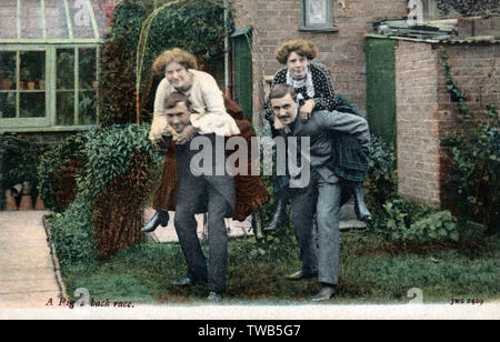 Two Couples have a piggy-back race in the back garden.     Date: circa 1910s - Stock Image