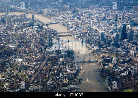 Aerial view of central London from the E on a sunny day looking along the Thames from Tower Bridge and including - Stock Image