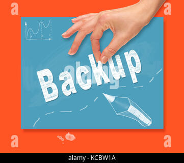 A hand picking up a Backup concept on a portable computer. - Stock Image