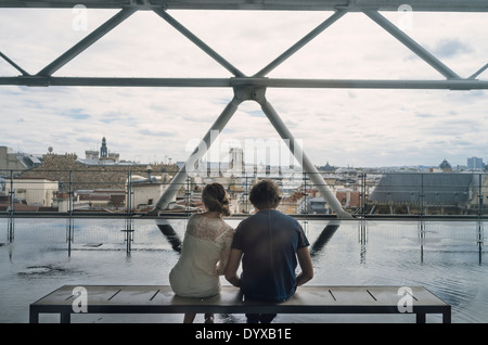 A couple enjoy the view from the Pimpidou Arts Centre balcony in the city of Paris, France. - Stock Image
