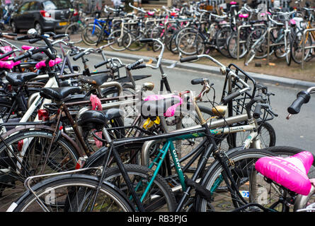 Bikes parked on a street in Amsterdam, the Netherlands - Stock Image