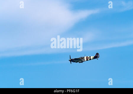 Spitfire of the Battle of Britain Memorial Flight in D-Day stripes at the Eastbourne Airshow 2018 - Stock Image