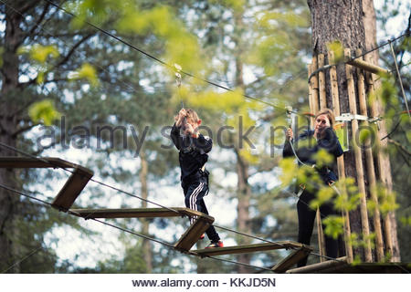boy with parent on high ropes - Stock Image