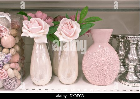 Flower vases and pot pourri on a shelf - Stock Image