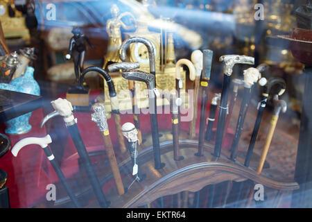 Walking sticks in Antique shop window Budapest - Stock Image