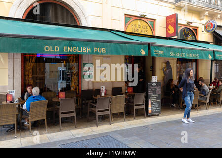 People drinking at The Sherlock Holmes - an 'English Pub' in Malaga, Spain, Europe - Stock Image