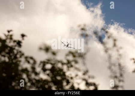 Commercial jet flying in distance - Stock Image