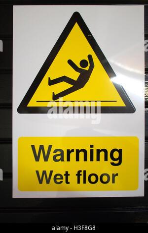 Caution Wet Floor SLIPPERY ! warning sign - Stock Image