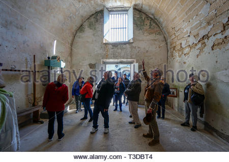 A tour group in an interior room at the Castillo de San Marcos, a Spanish fortification at St. Augustine, Florida USA - Stock Image