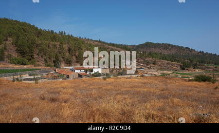 Tranquil countryside landscape with rustic houses, agricultural fields and animal farms in the highest village in Spain, Vilaflor, Tenerife, Spain - Stock Image