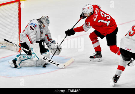 Bratislava, Slovakia. 14th May, 2019. L-R DAVID KICKERT (AUT) and NICO HISCHIER (SUI) in action during the match Switzerland against Austria at the 2019 IIHF World Championship in Bratislava, Slovakia, on May 14, 2019. Credit: Vit Simanek/CTK Photo/Alamy Live News - Stock Image
