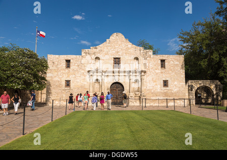 Tourists visit The Alamo on a sunny day San Antonio Texas USA - Stock Image