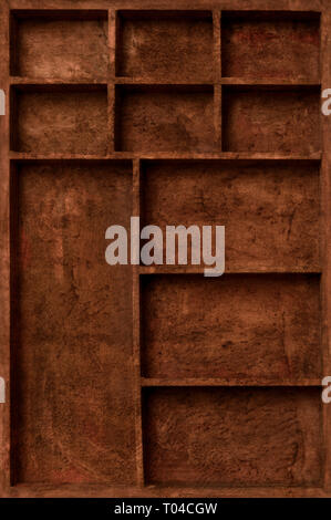 brown empty wooden box with compartments of various sizes - Stock Image