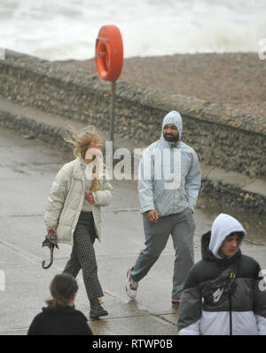 Brighton, East Sussex, UK. 3rd March 2019 .Visitors were determined to enjoy a walk on Brighton seafront today as Storm Freya arrived and started to batter parts of Britain today Credit: Simon Dack/Alamy Live News - Stock Image