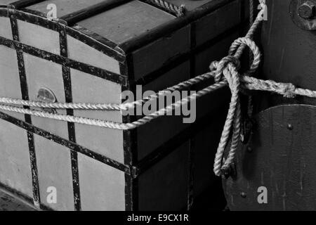 Sea chest tied to the mast on a tall ship. - Stock Image