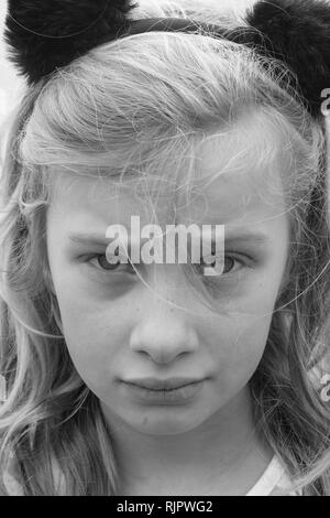 Black and white portrait of an unhappy, sad, hurting, preteen girl - Stock Image