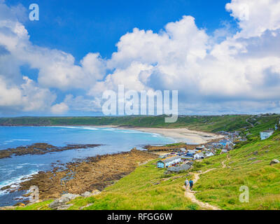 15 June 2018: Sennen Cove, Cornwall, UK - The South West Coast Path winds its way into Sennen Cove village. - Stock Image
