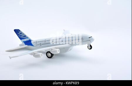 Plane plastic toy isolated on white background - Stock Image