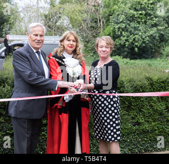 Biggin Hill, UK. 23rd Apr, 2019. Mayor of Bromley, Kim Botting, unveils a New flagpole in Biggin Hill Kent by the War memorial. The flag of St George was proudly flown after a short ceremony to remember England's patron Saint. She cut the ribbon with Councillor Julian Bennington and Councillr Melanie Stevens. Alan Everett has agreed to fly the Union Jack daily. Credit: Keith Larby/Alamy Live News - Stock Image