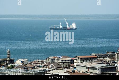 Cargo ship off Freetown, Sierra Leone. - Stock Image