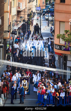 Resurrection Parade on Easter Sunday in Gandia Spain Virgin Mary Statueand the brotherhoods in their colourful outfits - Stock Image