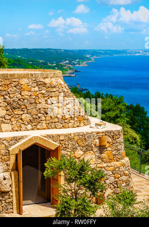 Trullo on Salento adriatic coast in Apulia - South Italy - typical rural dry stone building - Stock Image