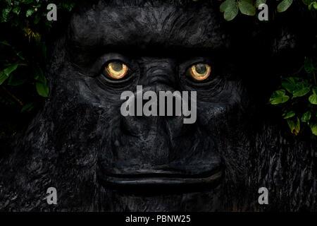 Gorilla face statue - Stock Image