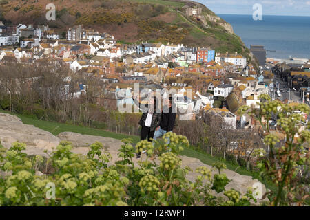 A couple take a selfie on the West Hill in Hastings, overlooking the Old Town, East Sussex, UK - Stock Image
