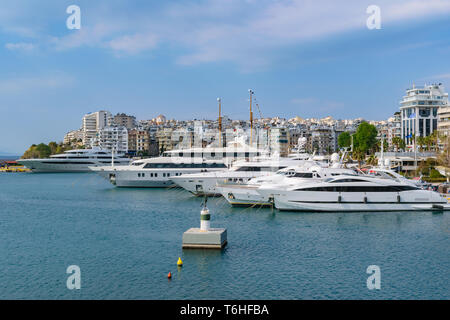 Piraeus, Greece - March 24 2019: Luxury yachts docked in Marina Zeas - Stock Image