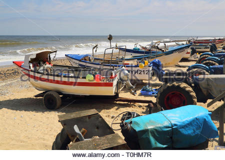 fishing boats on the beach at the seaside town of caister on the norfolk coast - Stock Image