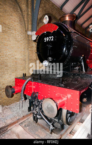 Close-up of the front of the Hogwarts Express Steam Engine at the making of Harry Potter Studio Tour, Leavesdon - Stock Image