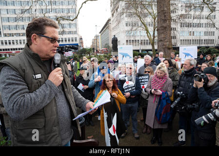 London, UK. 26th January 2019. London protest against the intended resumption of whaling by Japan.The Japanese government recently backed out of an international agreement banning commercial whaling. Campaigners rally at Cavendish Square for the march to the Japanese Embassy. Pictured on left, Will Travers from Born Free. Credit: Stephen Bell/Alamy Live News. - Stock Image