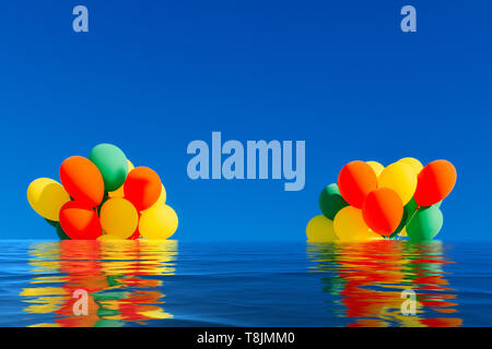 Flooded colorful balloons on a blue sky background with reflection on water. - Stock Image
