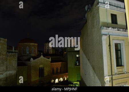 Athens View over Praxitelous Street at 3a.m, with towers of Ekklisia Panagia Chrysospiliaiotissa - Stock Image