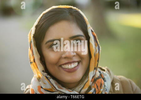 Portrait smiling, happy Muslim woman wearing hijab - Stock Image
