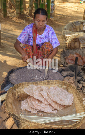 Woman preparing a delicious fried bread - Stock Image