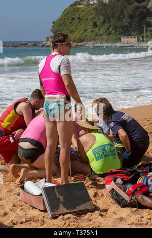 man rock fishing was rescued and feared drowned at Palm Beach Sydney, surf rescue lifeguards and others provide oxygen and CPR until ambulance arrive. - Stock Image