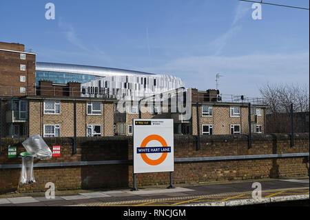 Tottenham London UK - White Hart Lane Railway station used by football fans going to Spurs matches with the Tottenham Hotspur Stadium in distance behi - Stock Image