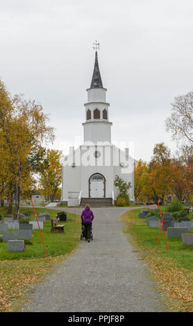 Bossekop, Alta church, in Alta, Finnmark, Northern Norway, with autumn colors at trees. - Stock Image