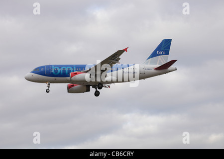 BMI British Midland Airbus A319-131 G-BDCH on approach to Heathrow : cloudy sky - Stock Image
