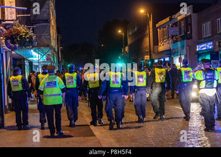 Brentwood Essex 11th June 2018 Approximately fifty police officers deployed in Brentwood Essex  following England losing against Croatia.  Fans tears turned to disorder and Essex police had to clear fans down the entire length of the High Street.  One small group of fans challenged the police and arrests were made. Credit Ian Davidson/Alamy Live News - Stock Image