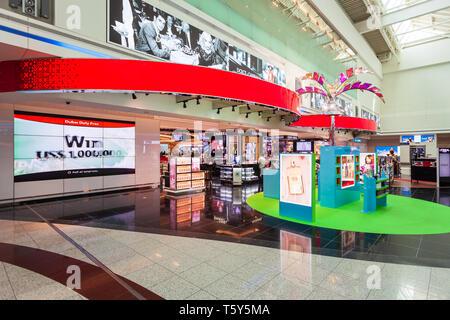 DUBAI, UAE - MARCH 02, 2019: Perfume shop in the duty free zone in the Dubai International Airport in UAE - Stock Image