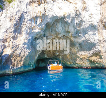 The White Grotto of the island of Capri, Italy.  Coastal Rocks on the Mediterranean Sea at Capri Island from a motor - Stock Image