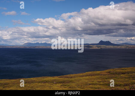 A view from the Coigach Peninsula to Assynt, Scotland with the sea, mountains and big sky with clouds - Stock Image