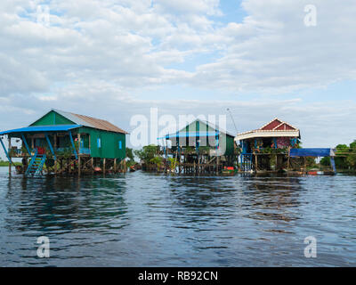 Stilted homes in Kampong Phluk floating village on Kampong Phluk River Siem Reap Cambodia Asia home to approximately 3000 predominately Khmer fishing  - Stock Image
