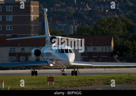 Business jet taxiing for departure at London City Airport, England, UK - Stock Image