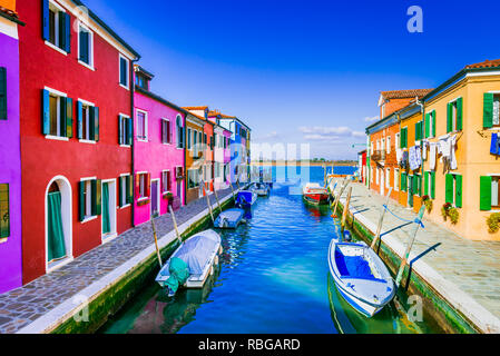 Burano, Venice. Image with colorful island and water canal from beautiful Veneto in Italy. - Stock Image